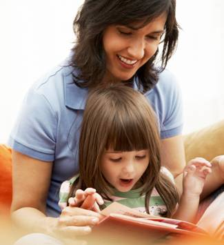 Mother reading to little girl.